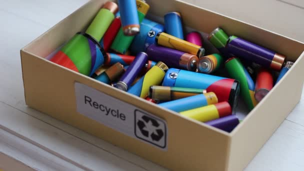 A recycling box for used batteries. The three chasing arrows of the international recycling logo