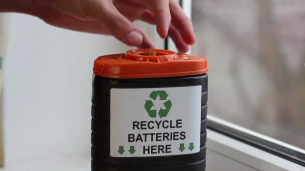 A recycling bin for used batteries. The three chasing arrows of the international recycling logo