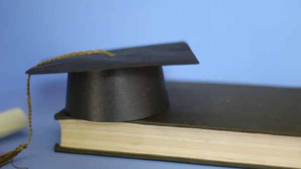 Learning concept. Isolated graduation cap and diploma dolly shot