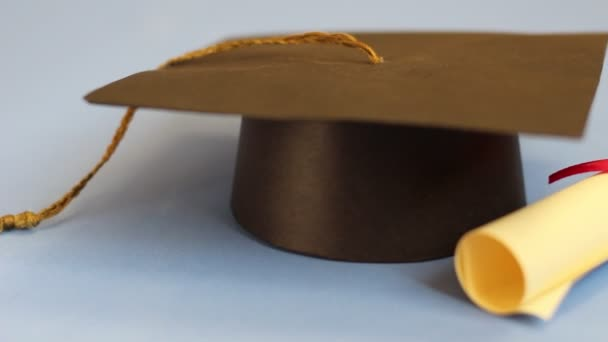 Student concept. Isolated graduation cap and diploma dolly shot