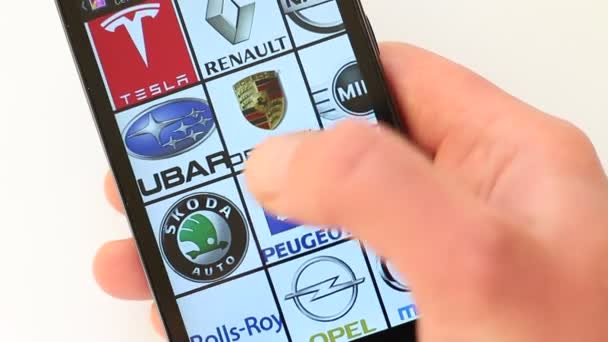 Popular Car Brands and Car Logos on smartphone screen. Citroen, Dodge, Fiat, Ferrari, Ford, Honda, Hyundai, Infiniti, Jeep, Jaguar, Lamborghini, Land Rover,  Lexus, Lincoln, Maserati, Mazda, Mercedes-Benz, Mini, Nissan, Opel, Peugeot, Porsche, Renaul