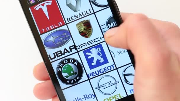 Popular Car Brands and Car Logos on smartphone screen. Acura, Alfa Romeo, Aston Martin, Audi, BMW, Bentley, Bugatti, Buick, Cadillac, Chevrolet, Citroen, DS Automobiles, Dodge, FIAT, Ferrari, Ford, Honda, Hyundai, Infiniti, JEEP, Jaguar, Lamborghini,