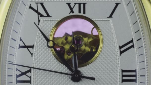 macro shot Mechanical wrist watch timelapse counting time to midnight, starting new day or new year