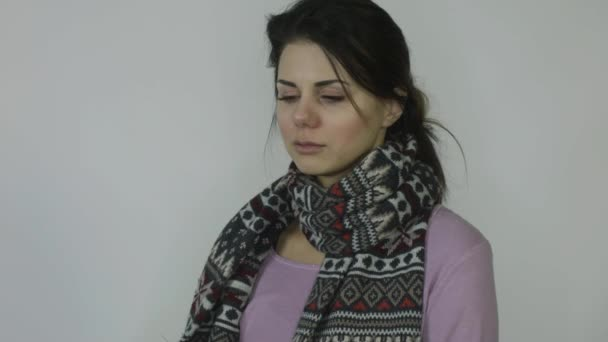 Ill girl with runny nose in scarf with temperature coughs