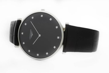Saint-Imier, Switzerland, 2.02.2020 - Longines automatic silver steel body with bracelet watch close-up, black clock face macro isolated. Longines is Swiss luxury watchmaker, part of Swatch group.