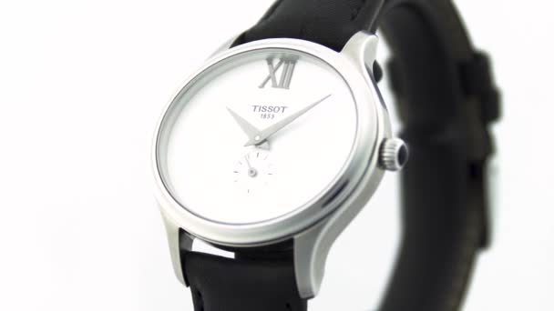 Le Locle, Switzerland 15.01.2020 - Tissot woman watch stainless steel case, white clock face dial, leather strap, swiss quartz mechanical watch isolated, swiss made manufacture rotating stand close-up