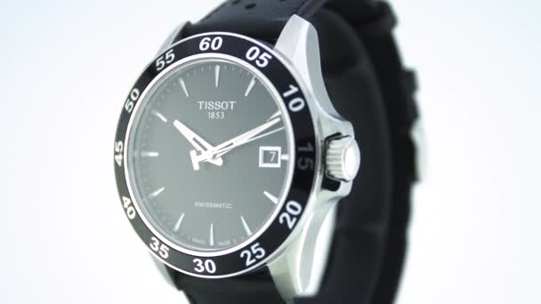 Le Locle, Switzerland 15.01.2020 - Tissot man watch stainless steel case, black clock face dial, leather strap, swiss quartz mechanical watch isolated, swiss made manufacture