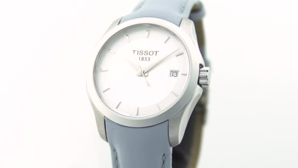 Le Locle, Switzerland 15.01.2020 - Tissot woman watch stainless steel case, white clock face dial, leather strap, swiss quartz mechanical watch isolated, swiss made manufacture close-up
