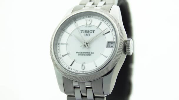 Le Locle, Switzerland 15.01.2020 - Tissot woman watch stainless steel case, white clock face dial, metal bracelet, swiss quartz mechanical watch isolated, swiss made manufacture close-up