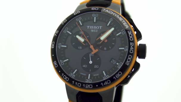 Le Locle, Switzerland 15.01.2020 - Tissot man watch stainless steel case, black clock face dial, sport rubber strap, swiss quartz mechanical watch isolated, swiss made manufacture close-up