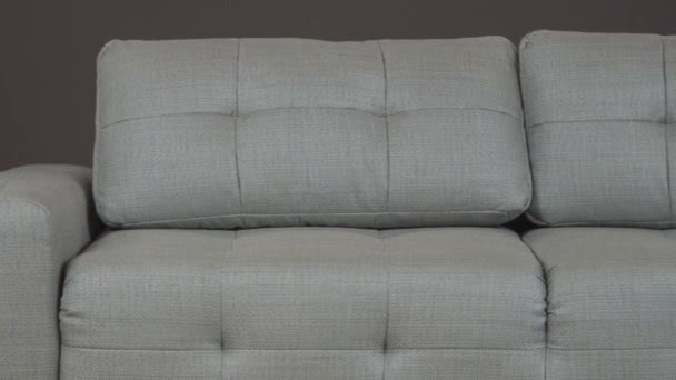 Classic sofa with gray textile upholstery. Fits perfectly into the interior.