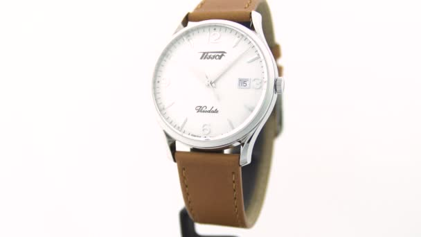 Le Locle, Switzerland 15.01.2020 - Tissot man watch stainless steel case, white clock face dial, leather strap, swiss quartz mechanical watch isolated, swiss made manufacture
