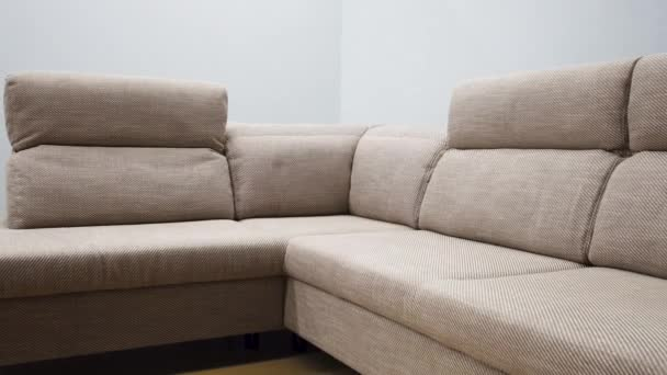 Ascetic corner sofa with stylish beige textile upholstery