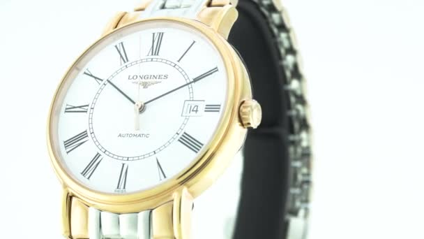 Saint-Imier, Switzerland, 2.02.2020 - Longines watch white clock face dial close up stainless steel bracelet . classic elegant swiss made watches