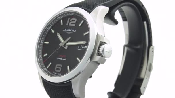 Saint-Imier, Switzerland, 2.02.2020 - Longines watch black clock face dial leather strap . fashionable modern swiss watches