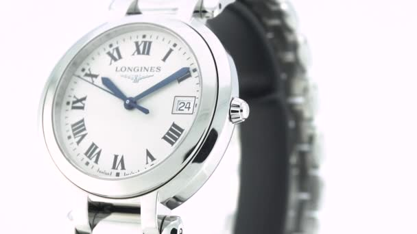 Saint-Imier, Svájc, 2.02.2020 - Longines watch white clock face dial close to stainless steel bracelet