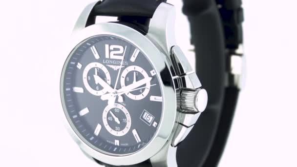 Saint-Imier, Svájc, 2.02.2020 - Longines watch black clock face dial close up leather strap. divatos modern svájci órák