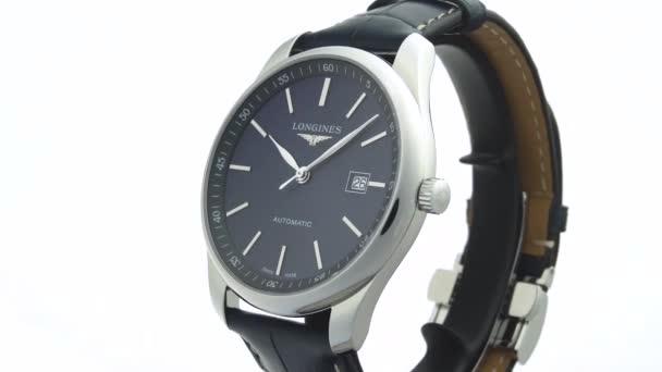 Saint-Imier, Svájc, 2.02.2020 - Longines watch black clock face dial leather strap. klasszikus elegáns svájci készült órák