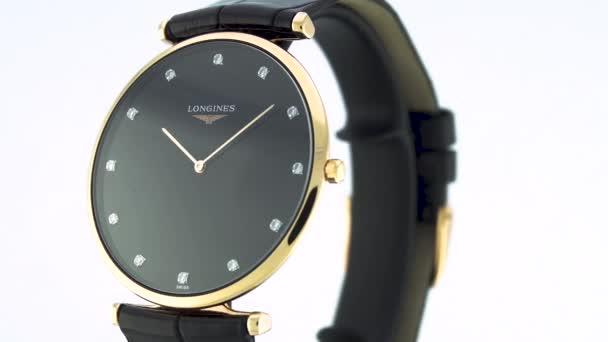 Saint-Imier, Switzerland, 2.02.2020 - Longines watch black clock face dial close up leather strap