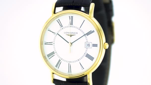Saint-Imier, Switzerland, 2.02.2020 - Longines watch white clock face dial close up leather strap . classic elegant swiss made watches