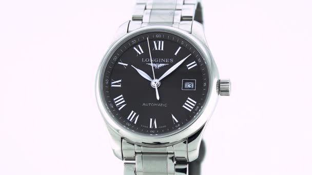 Saint-Imier, Switzerland, 2.02.2020 - Longines watch black clock face dial close up stainless steel bracelet . classic elegant swiss made watches
