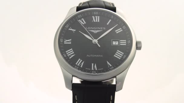 Saint-Imier, Switzerland, 2.02.2020 - Longines watch black clock face dial leather strap . classic elegant swiss made watches