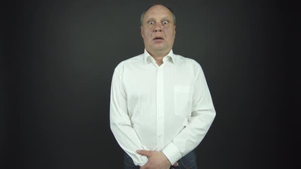 senior man in shirt performs shock emotions at audition