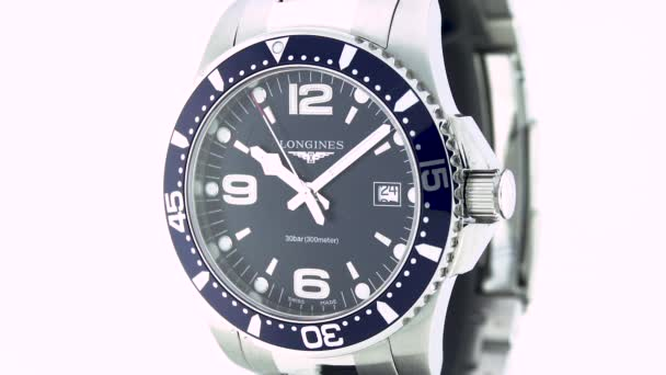 Saint-Imier, Switzerland, 2.02.2020 - Longines watch black clock face dial close up stainless steel bracelet . fashionable modern swiss watches