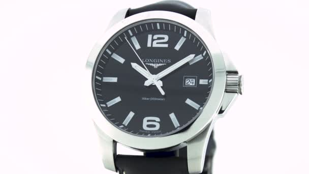 Saint-Imier, Switzerland, 2.02.2020 - Longines watch black clock face dial close up leather strap . classic elegant swiss made watches