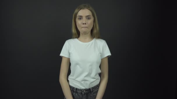 sad lady in white t-shirt breathes deeply and looks straight
