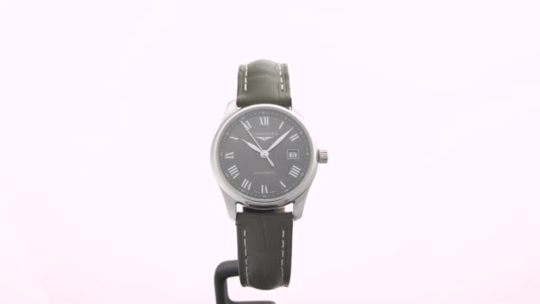 Saint-Imier, Switzerland, 2.02.2020 - Longines watch black clock face dial leather strap