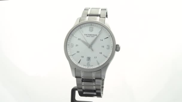 Ibach, Switzerland 7.04.2020 - Victorinox Man watch stainless steel case white clock face dial stainless steel bracelet isolated on white background
