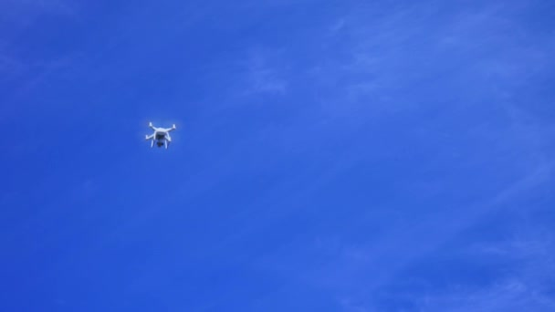 Copter, drone flying in a blue sky, Quadrocopter flies away