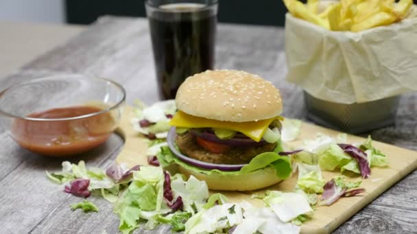 Panning arround on Delicous home made hamburger with fries on wooden table
