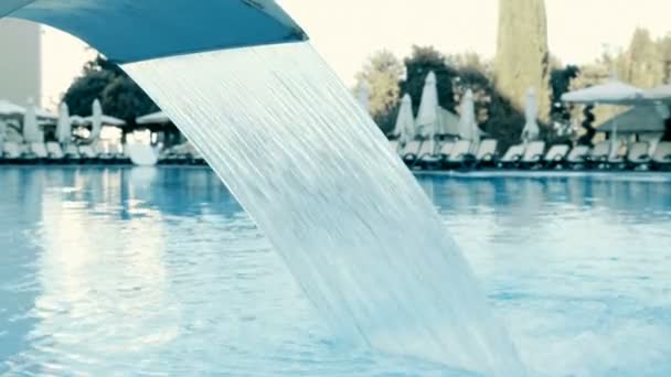 Water fountain treatment in the pool of luxury hotel