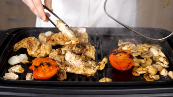 Grilled boneless chicken on a grill