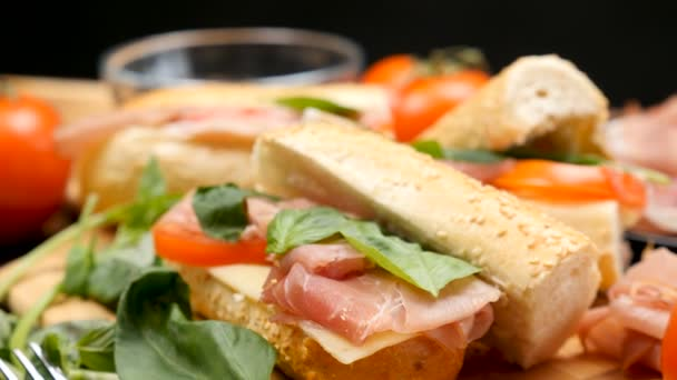 Healthy delicous sandwich made of prosciutto, cheese and tomatoes at the kitchen