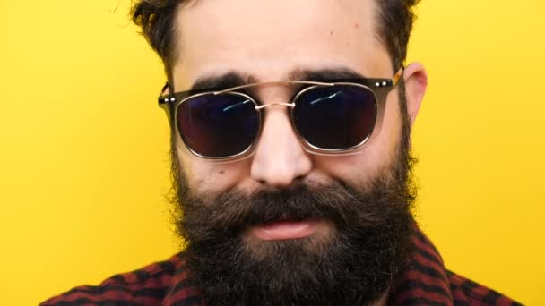 Long bearded men with sunglasses on smiling