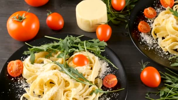 Delicious traditional italian tagliatelle pasta in black plates