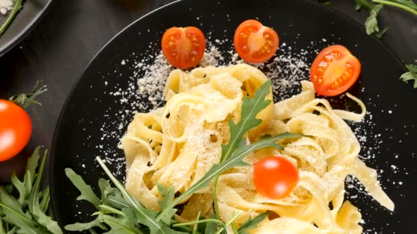Delicious tagliatelle pasta with parmesan cheese on top