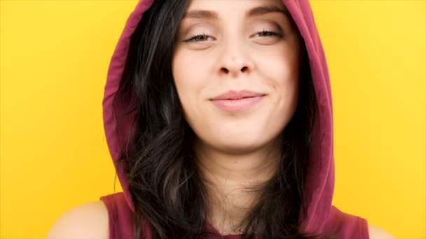 Woman laughing large to the camera wearing a hood
