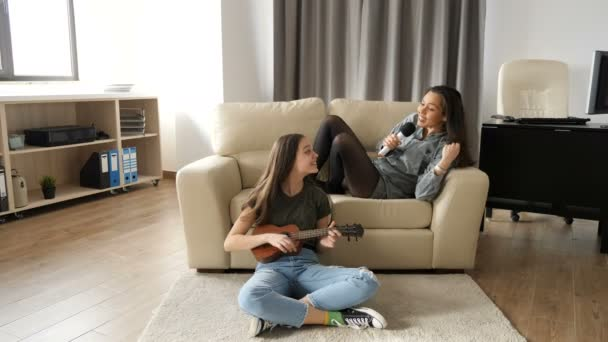 Two sisters in the living room having a good time