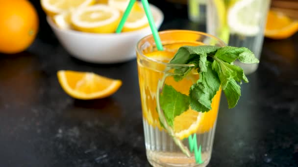 Sweet orangeade water with fresh oranges and mint
