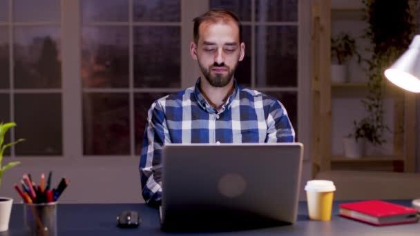 Bearded entrepreneur taking a sip of coffee