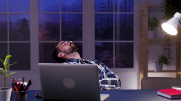 Tired businessman sleeping on chair in his home office