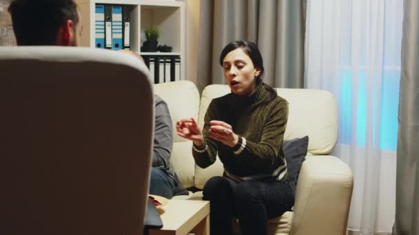 Zoom in shot of angry young wife at couple therapy