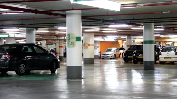Tel Aviv/israel - Nov 24, 2014:underground Garage With the Moving Cars and Parked Cars
