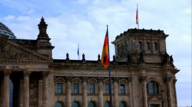 Flags on Reichstag, Germanys Parliament Building in the Heart of the Capital at Summer Cloudy Dark Day