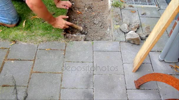 Worker Prepares Place For Laying of Concrete Paving Slabs