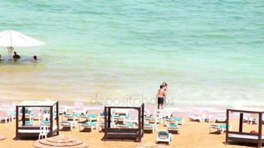 Young couple make photo for memory at Dead sea beach